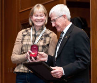 Dr. Wayne Burwash accepts the Alberta Horse Industry Distinguished Service Award from HIAA President Jean Kruse. Supplied photo.