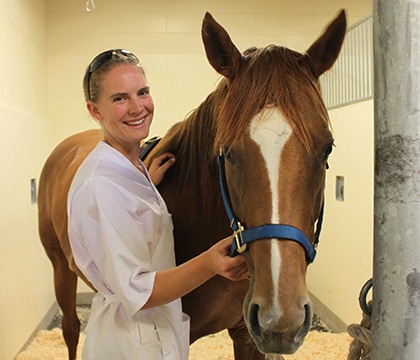 Jessica Semper with one of the horses involved in the firocoxib study. Submitted photo